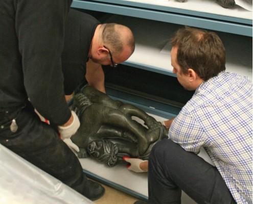 Winnipeg Art Gallery staff prepare to lift a heavy sculpture